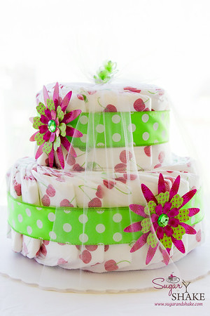 A girly diaper cake for a cute little girl. © 2014 Sugar + Shake