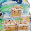 Diaper cake + sprinkle cupcakes = Recipe for a delicious baby shower. © 2014 Sugar + Shake