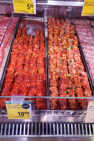 Spicy Pork Belly skewers at the butcher counter at Foodland Farms Ka Makana Aliʻi. © 2020 Sugar + Shake