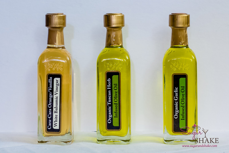 To season the fish: some wonderfully fragrant oil & vinegar from the newly opened Island Olive Oil shop. The Garlic Olive Oil and Cara Cara Orange/Vanilla White Balsmaic Vinegar were used to marinate the fish before broiling. © 2013 Sugar + Shake