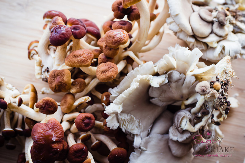 An assortment of Pioppini (the brown ones) and Gray Oyster mushrooms from Hamakua Heritage Farm in Laupāhoehoe on the Big Island. © 2013 Sugar + Shake
