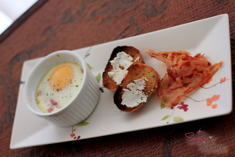 Baked Eggs in Tomato Sauce, Big Island Goat Cheese, Crispy Speck. © Sugar + Shake