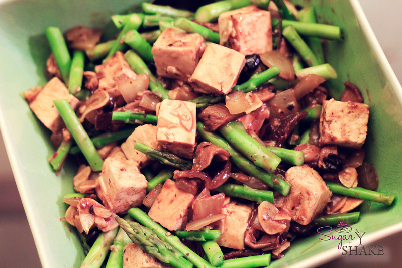 Tofu, asparagus, shiitake mushrooms, onions and a LOT of garlic stir-fried in a black bean and to ban jian sauce. © Sugar + Shake