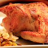 Roast chicken, stuffed with oranges, lemon, celery, onion and garlic. © Sugar + Shake