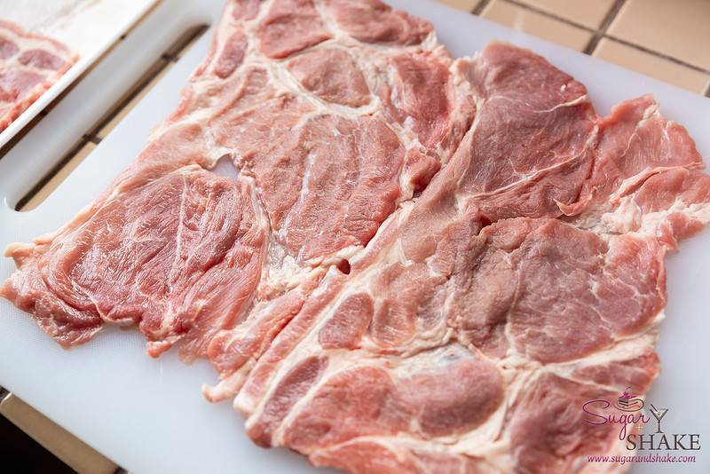 Lay your pork pieces out like a sheet of paper.  © 2021 Sugar + Shake