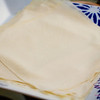 Lumpia wrappers. They come very stuck together, so pull them apart before you start rolling lumpia. © 2013 Sugar + Shake