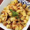 Breakfast potatoes—potatoes pan-fried with garlic and onions. For this batch, Sugar pre-steamed the potatoes with lemon thyme (it speeds up the cooking—the steaming, not the herbs) and tossed the taters with lemon-infused olive oil. © Sugar + Shake