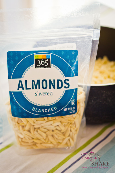 Buy blanched almonds. You don't want to spend even more time dealing with removing the skins. Whole is fine, but if they are already chopped, that saves more time. © 2012 Sugar + Shake