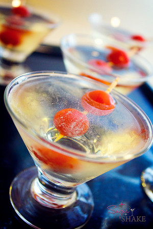 Sugar's Tomato Water Gin Shooters. Equal parts Sugar's secret recipe tomato water and Hendrick's gin. Garnished with Ho Farms currant tomatoes. © Sugar + Shake