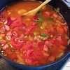Add a can or two of crushed tomatoes and add water to cover. © 2012 Sugar + Shake