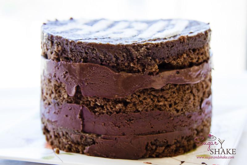 The Chocolate Bourbon Smoked-Tea Cake features three layers of cake and two layers of Chocolate Bourbon Ganache. © 2013 Sugar + Shake
