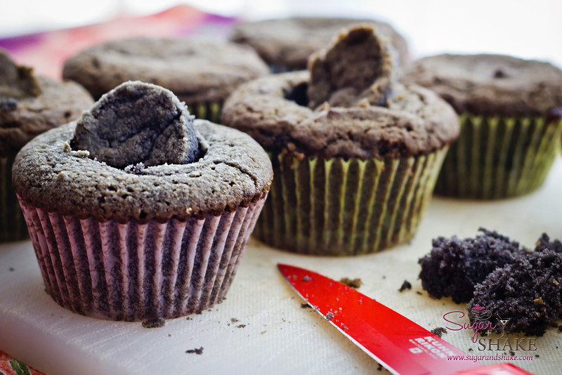 Cutting divots in cooled cupcakes for the ginger curd filling. © 2012 Sugar + Shake