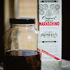 Soaking dried cherries in maraschino liqueur for homemade maraschino cherries. © 2012 Sugar + Shake