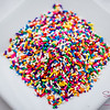 If a pile of rainbow sprinkles does not make you smile, even just a little, you have a hole in your sick, sad soul. © 2013 Sugar + Shake