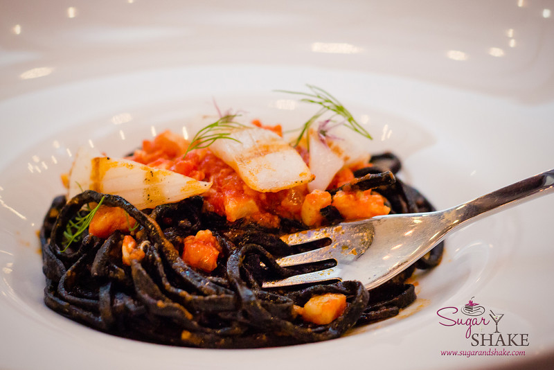 Chitarra alla Pescatora (lobster, scallop, shrimp, calamari, fresh house made squid ink chitarra, spicy tomato sauce) at Arancino at The Kahala Hotel. © 2014 Sugar + Shake