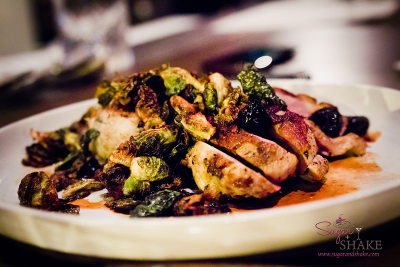 Duck Breast & Duck Confit Hash with Cherry Sauce & Fried Brussels Sprouts at Livestock Tavern. © 2014 Sugar + Shake