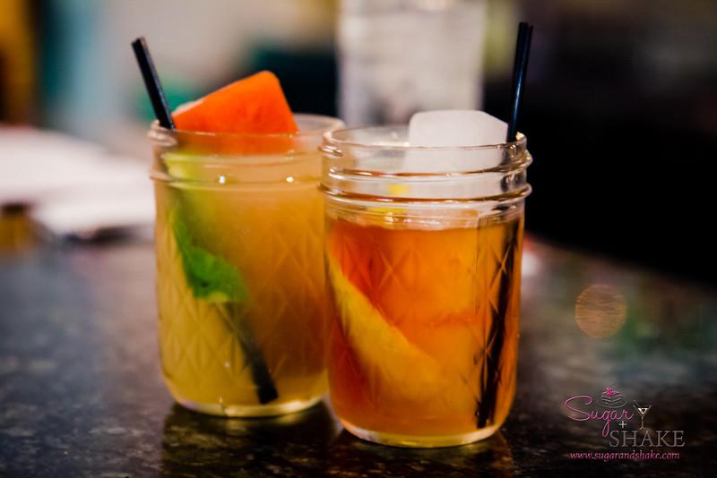 Drinks at The Pig & The Lady! Cobra Commander on the left (avocado mezcal, pink-grapefruit liqueur & sriracha ice). © 2014 Sugar + Shake