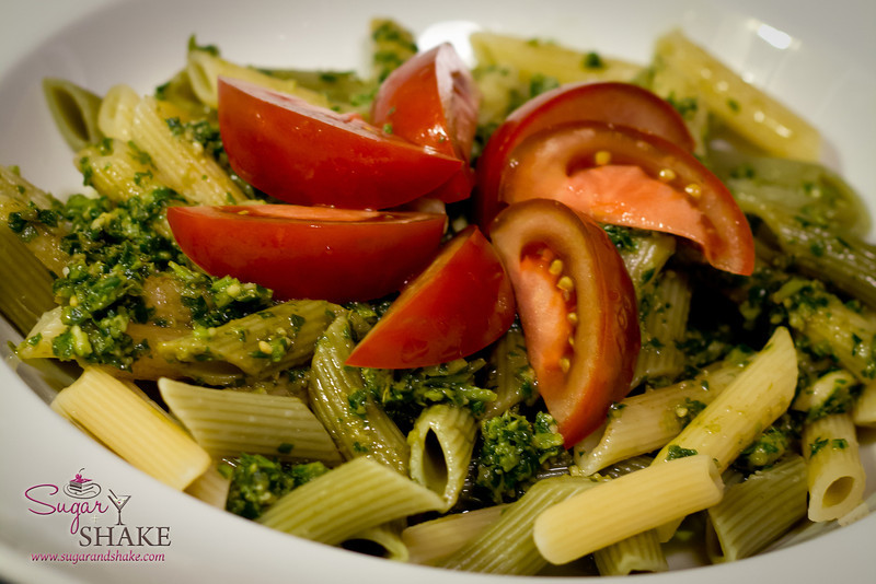 "The finished Kumu Farms pesto pasta dish. Technically, this is a homemade dish, but since it was made using a prepared pesto, it pretty much belongs in the ""We At It"" Gallery. © 2012 Sugar + Shake"