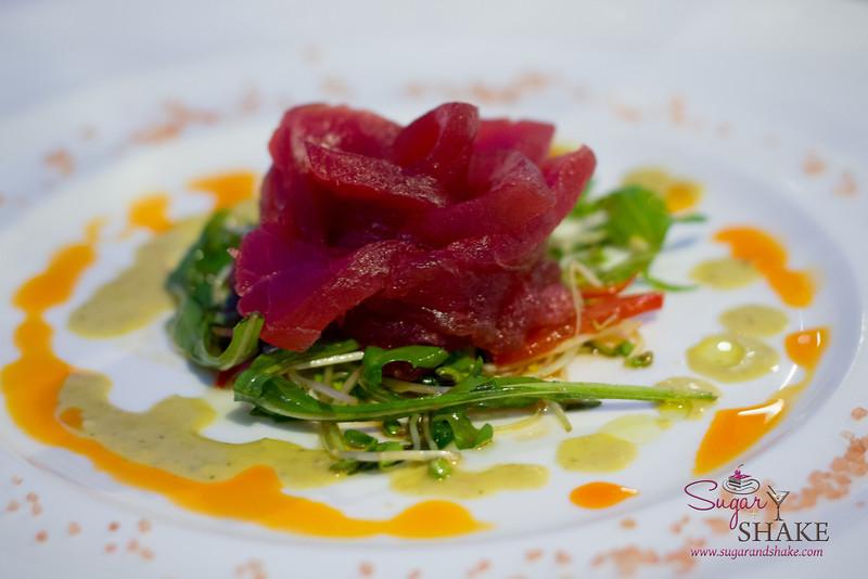 'Ahi sashimi rose by Chef Darren Ogasawara of Brown's Beach House, Fairmont Orchid. 'Ahi, Truffle Basil Vinaigrette, 'Alaea Salt, Mizuna Garlic Soy. © 2014 Sugar + Shake