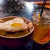 The perfect post-bar outing snack: The Pig & The Lady's Chicken Fat Fried Rice (topped with chicken cracklin's and an egg, of course). © 2014 Sugar + Shake