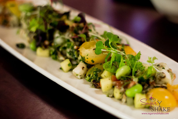 New bar menu tasting at Hula Grill Waikiki. Grilled Hawaiian Tako: Locally caught octopus, mango edamame chimichurri, cherry tomatoes. © 2014 Sugar + Shake