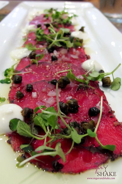 Peppered beef carpaccio with capers, horseradish cream, shallots, red sea salt, and olive oil at Hilo Bay Café. Probably THE BEST carpaccio we have ever had. (The capers are fried. Yum!) © 2012 Sugar + Shake