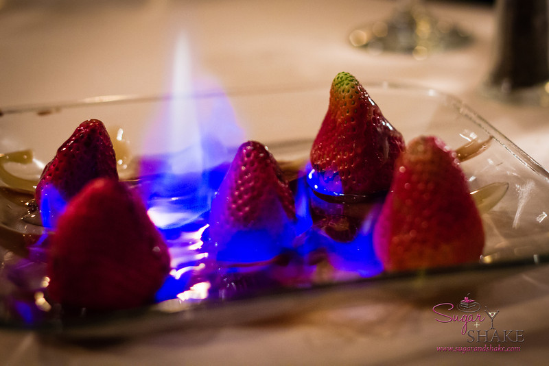 From all the desserts, you would think Shake was the dessert fiend, not Sugar. Birthday dessert at Ruth's Chris Steakhouse — flaming strawberries with brown sugar. © 2013 Sugar + Shake