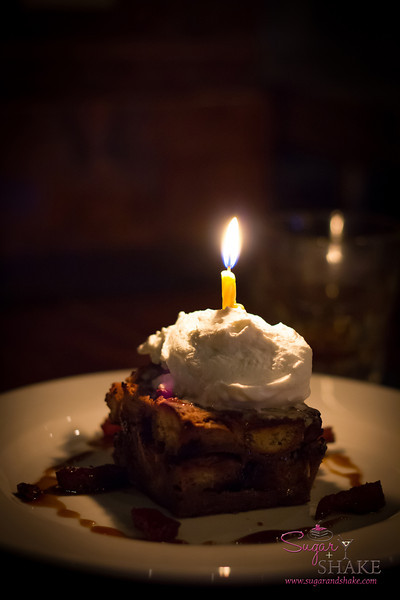 Since we were still celebrating Shake's birthday, Dave served up a piece of chocolate bread pudding...it comes with chunks of candied bacon. Of course it does. © 2013 Sugar + Shake