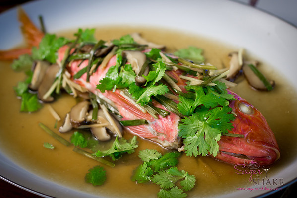 Christmas dinner at Sugar's parents' house. Steamed fish (weke 'ula — red goatfish) with Chinese parsley, shiitake mushrooms and ginger. © 2012 Sugar + Shake