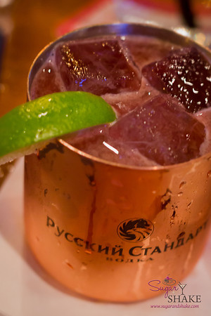 """Dave, make me something with vodka, please,"" says Sugar. ""OK,"" says Dave, and hands over this twist on a mule with vodka infused with citrus, campari, cassis, fresh muddled ginger, Peychaud's bitters and Bundaberg Ginger Beer. Well, that'll do. © 2012 Sugar + Shake"