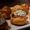 """""""Beer-a-Misu"""" Puffs from Off the Wall Craft Desserts & Kitchen. Mini cream puffs filled with mousse and coffee-beer-soaked lady fingers. #DessertFirst © 2015 Sugar + Shake"""