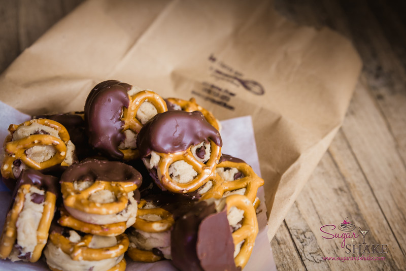 Fan-freaking-tastic! Desserts at the bar! Chocolate-dipped, cookie dough-stuffed pretzels by Let Them Eat Cupcakes, now housed in Bethel Street Tap Room. © 2014 Sugar + Shake