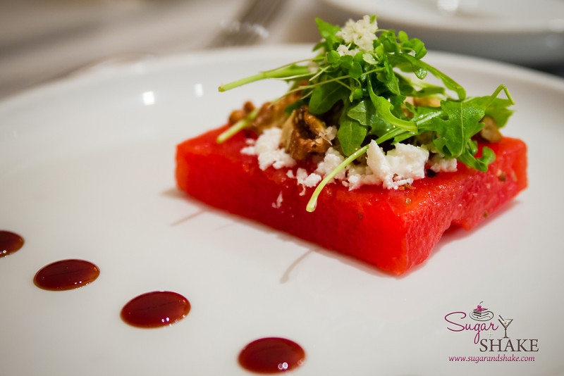 Watermelon Salad at Ka'ana Kitchen with feta, horseradish, arugula, candied walnuts. © 2014 Sugar + Shake