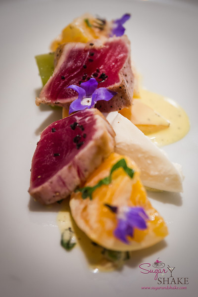'Ahi Tataki at Ka'ana Kitchen with Haiku heirloom tomatoes, fresh burratta, liliko'i. © 2014 Sugar + Shake