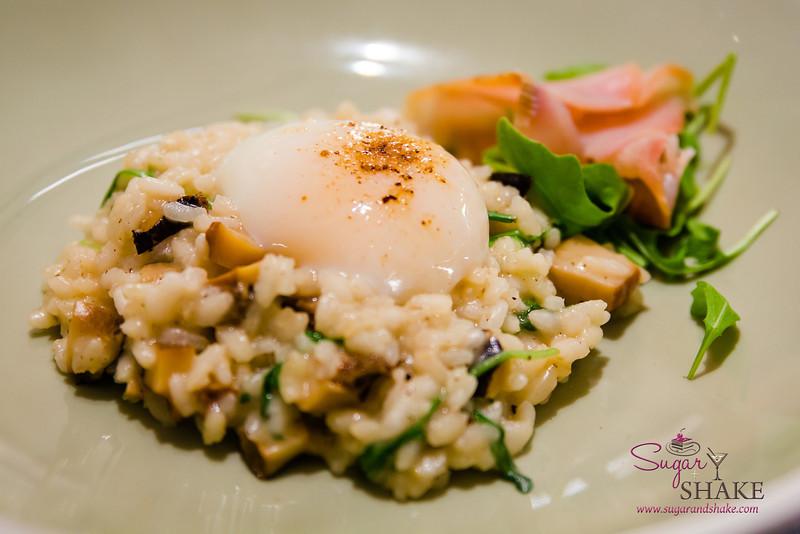 Abalone Risotto at Ka'ana Kitchen with kampachi bacon, onset egg, saikyo miso. © 2014 Sugar + Shake