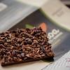"Mānoa Chocolate's ""Breakfast Bar,"" coated with cacao nibs and roasted Kona espresso bean bits. © 2014 Sugar + Shake"