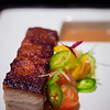 Chef Sheldon Simeon creation: Crispy Pork Belly with Tomatoes and Peppers. © 2013 Sugar + Shake