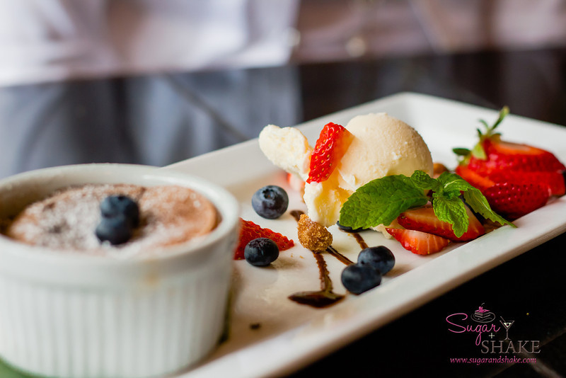 Hot Chocolate Lava Cake, served with fresh fruit and ice cream, at Three's Bar & Grill in Kihei. © 2013 Sugar + Shake
