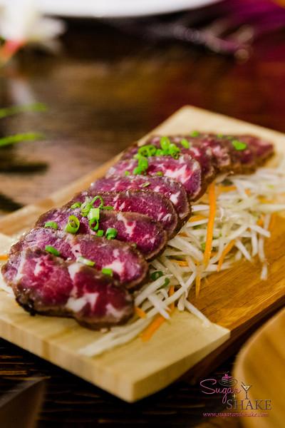 Maui Cattle Co. dried beef over green papaya salad. #MalamaMaui media dinner at Travaasa Hāna's Ka'uiki Restaurant. © 2015 Sugar + Shake