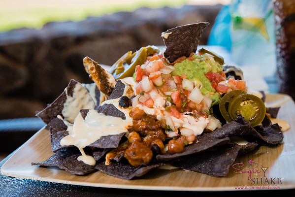 Food Truck Nachos: Maui Cattle Co. beef chili, pepperjack queso sauce, chipotle cream, jalapenos, guacamole and pico de gallo. Westin Kā'anapali Ocean Resort's Pailolo Bar & Grill. © 2015 Sugar + Shake