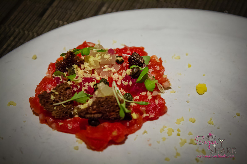 Another insanely creative dish by the young Flynn McGarry: Tartare...made entirely of tomato. Served with the traditional tartare accompaniments: capers, rye chips, red onion, egg yolk. © 2013 Sugar + Shake
