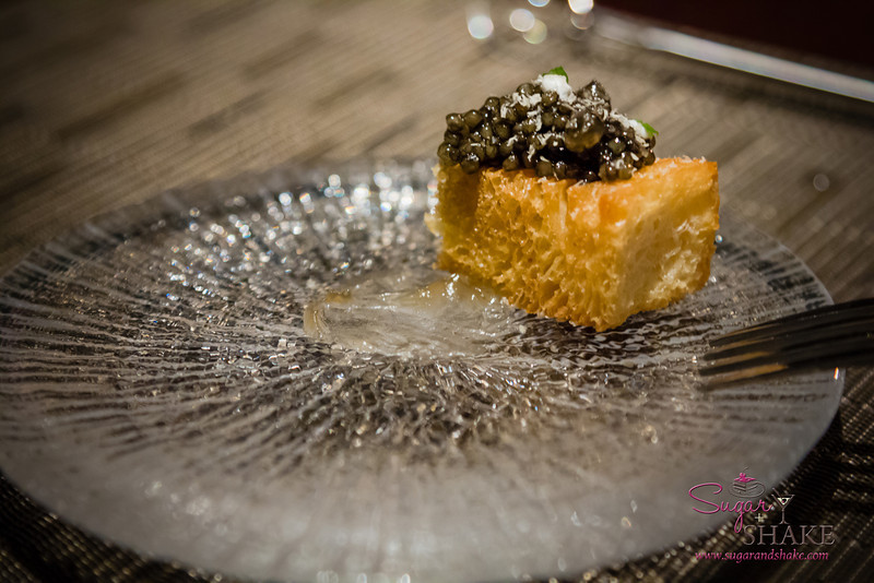 Beneath the brioche is a sweet, clear gel. It perfectly balances out the rich butteriness of the brioche and the salty fish taste of the caviar. One of the most amazing bites we have ever experienced. © 2013 Sugar + Shake