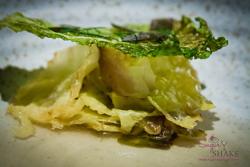 Chef Chris Kajioka does amazing things with cabbage. An odd thing to say, but making cabbage into something that you are excited to eat is pretty special. Here the cabbage is presented both sautéed and crisped, with a dashi broth and créme fraiche. © 2013 Sugar + Shake