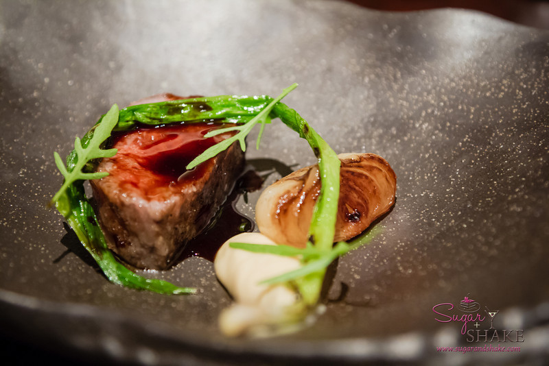 Miyazaki A5 Wagyu from Japan with alliums and black garlic. © 2013 Sugar + Shake