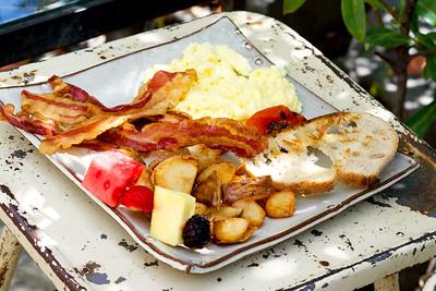 Scrambled eggs, grilled tomatoes, yukon gold potato, toast, smoked bacon, fruit kabob