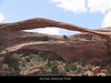 """Arches National Park, in southeastern Utah, is famous for the arches and natural bridges formed by the action of water. This is perhaps the most famous, the """"Landscape Arch"""".  <br /> <br /> While the mountains of the Sierra can seem timeless compared to the brevity of human life - in fact they are continuously breaking and falling and washing to the sea.  Here at Arches the transience of even solid rocki is more visible to us.  Huge sections of rock have fallen from this arch in recent years, and someday it will collapse."""