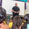 A Tustin Police Officer talks to the Fast Forward 1st Grade class about what it takes to work at the Tustin Police Department.
