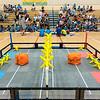 High School robotics students referee a competition between elementary school robotics students.