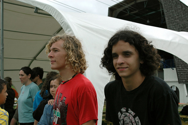 Jacob and Matthew watch the activities and await their turn to participate.