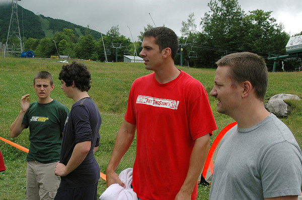 Bro. Andrew Wentworth and Bro. Aaron Johnson look on at the craziness taking place on the rain soaked field.